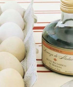 eggs with a bottle of balsamic vinegar