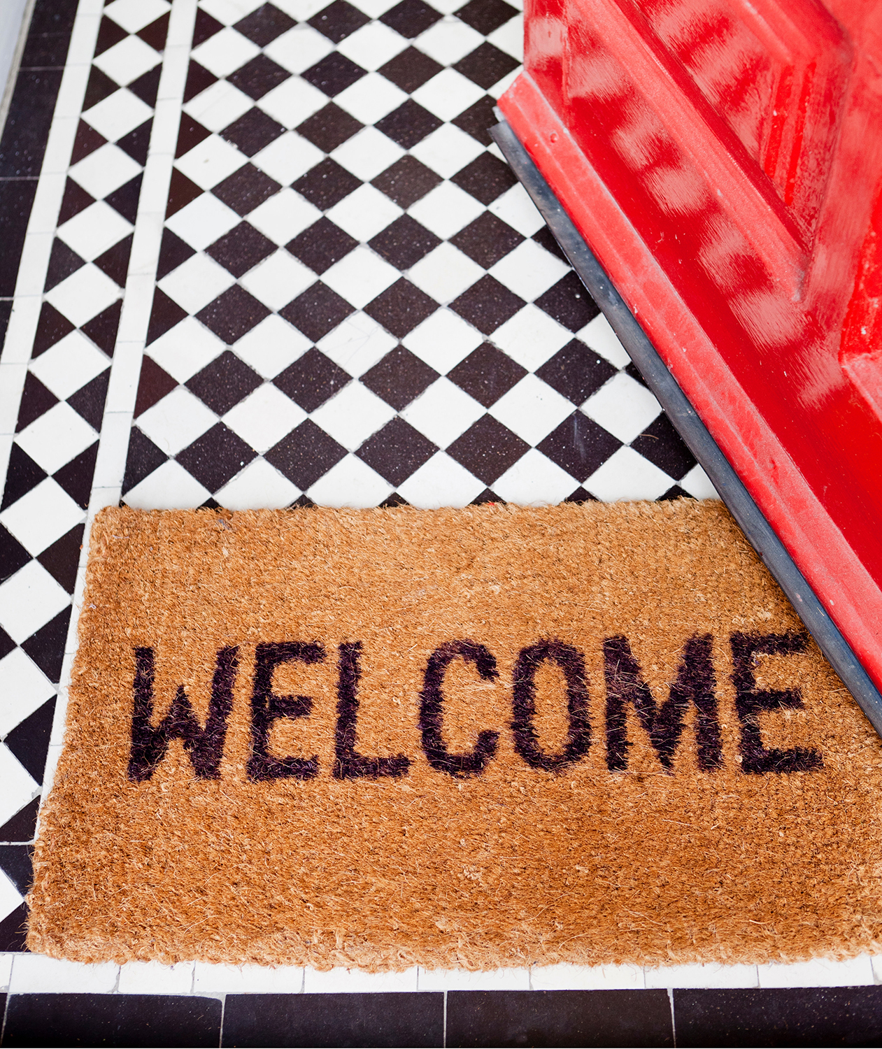 Welcome mat with red door and black and white floor