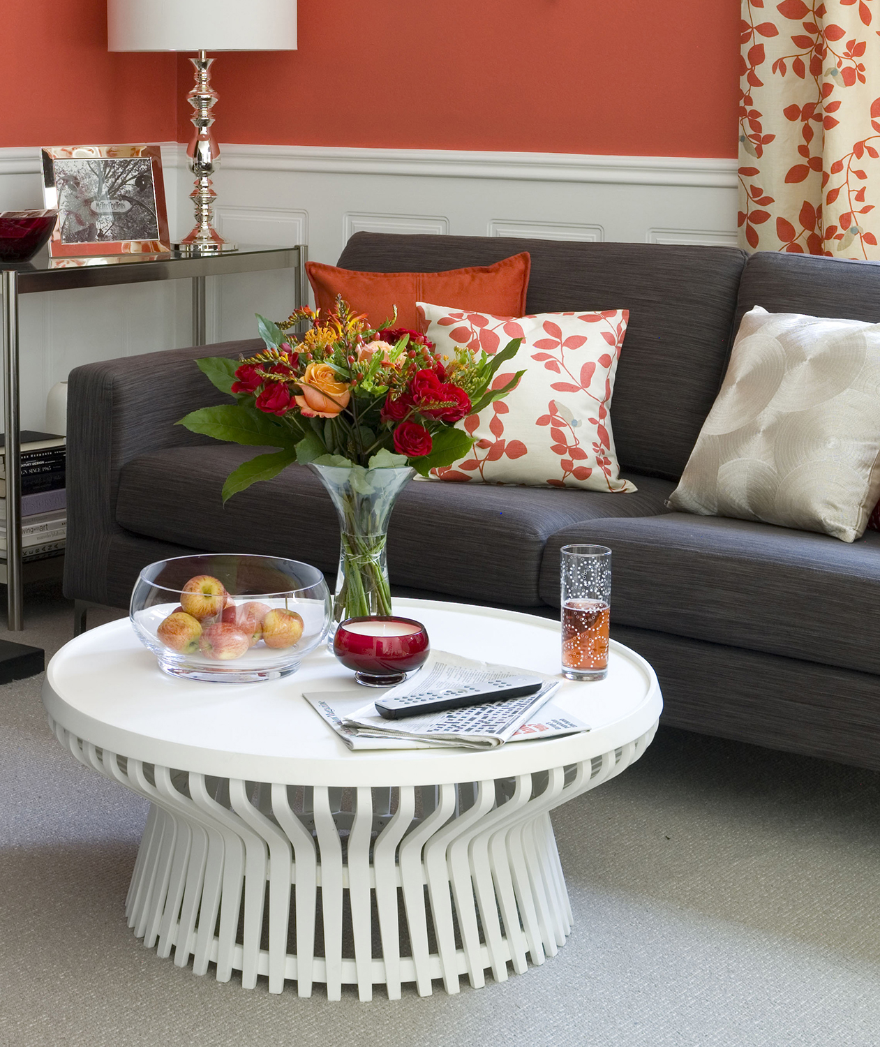 Sofa details with throw pillows in red room