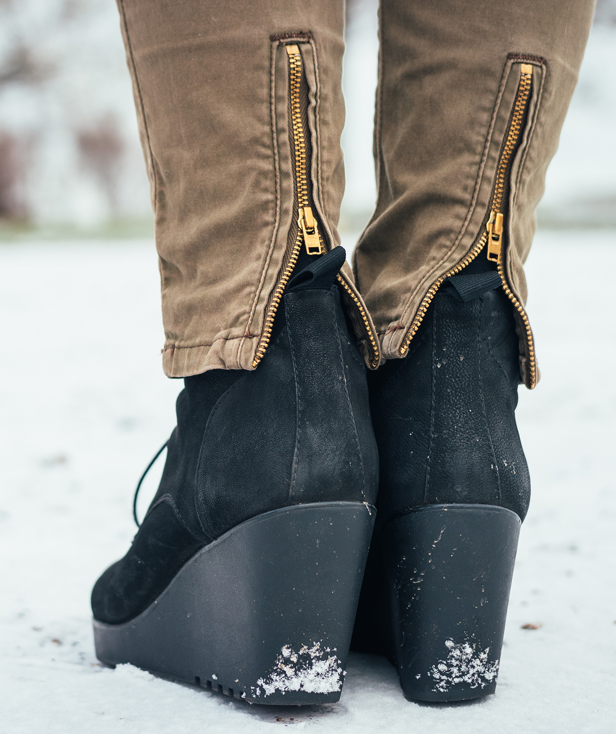 Black wedge heels in the snow