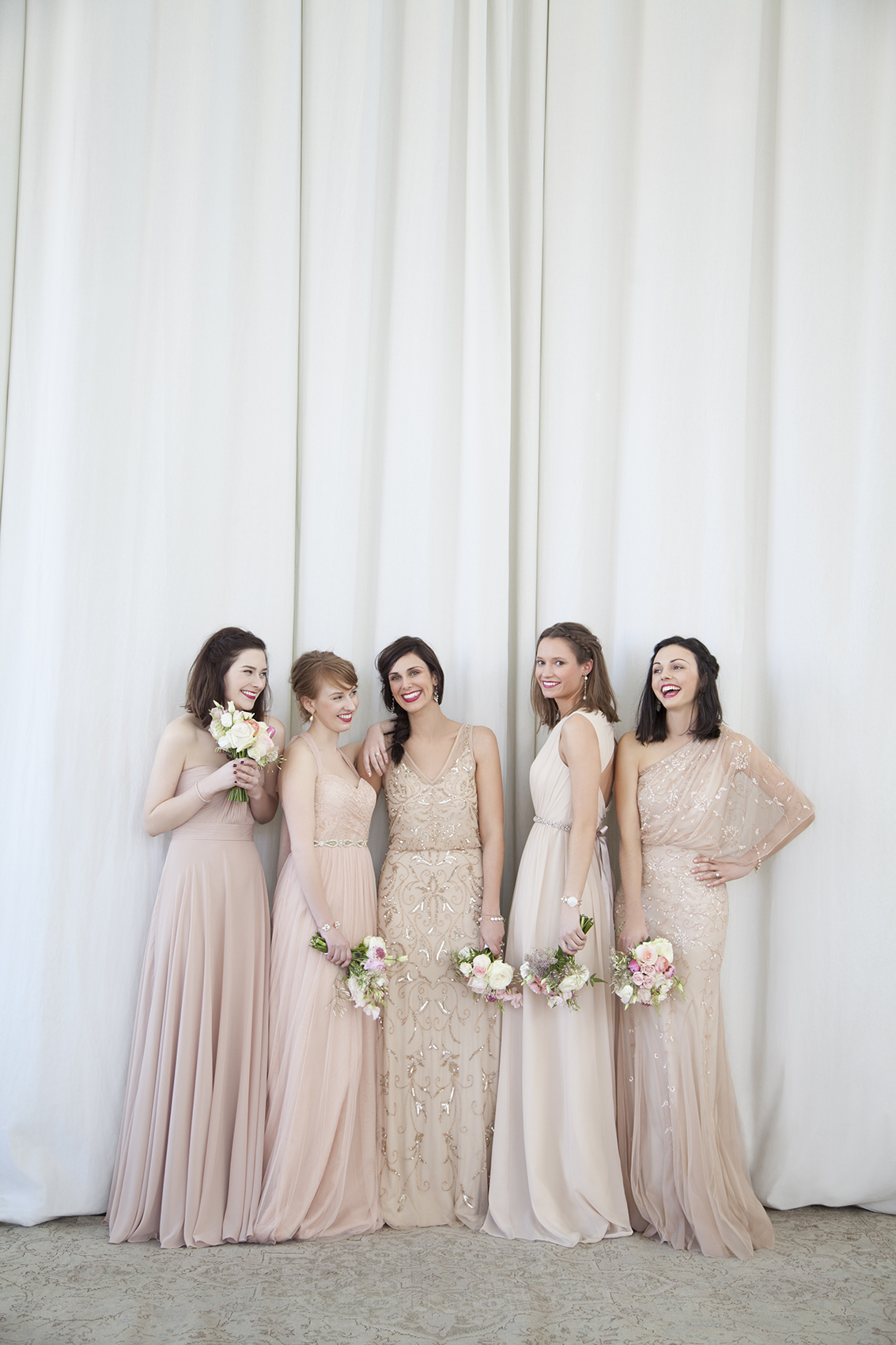 5 bridesmaids wearing dresses from BHLDN