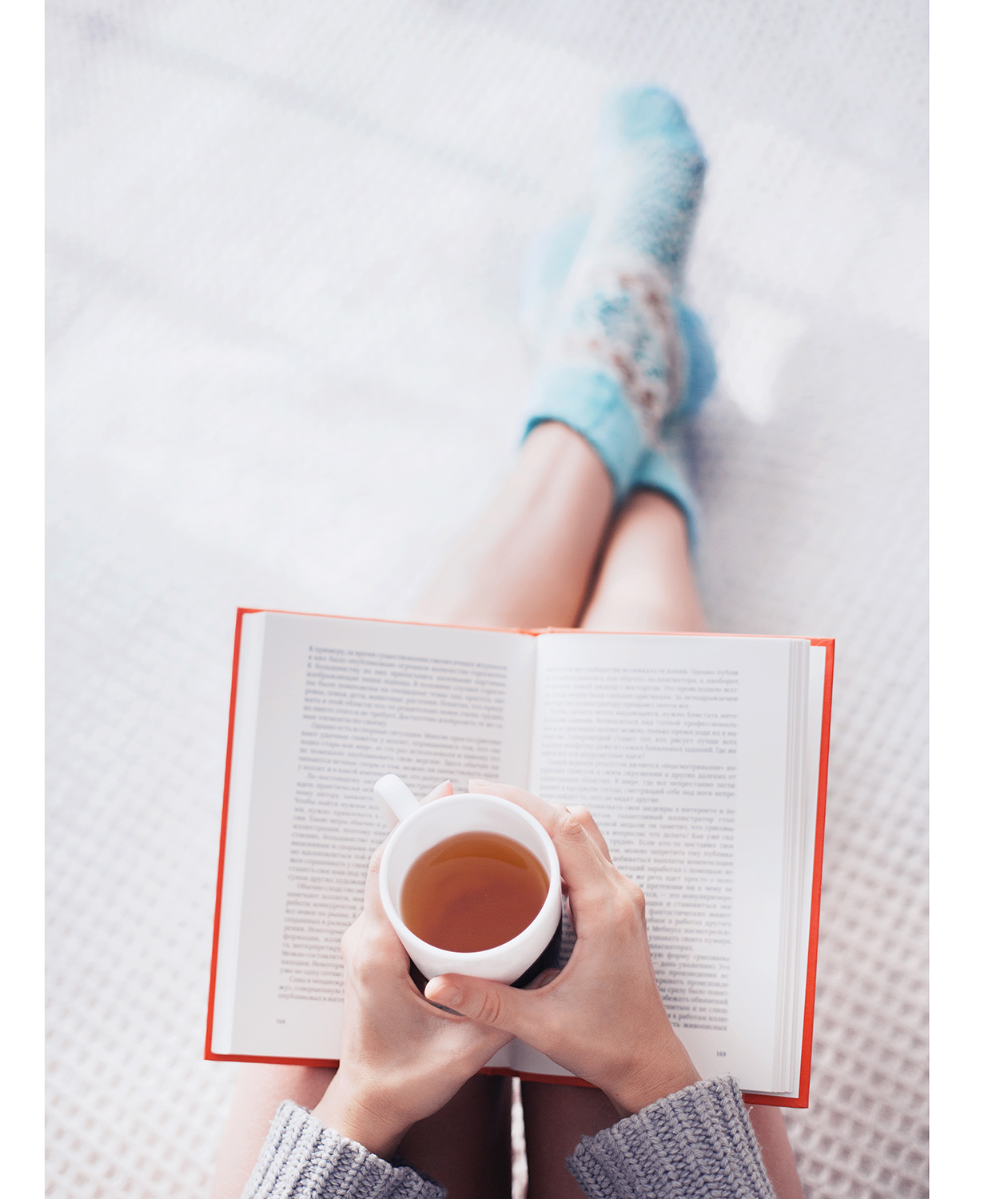 Woman reading with tea
