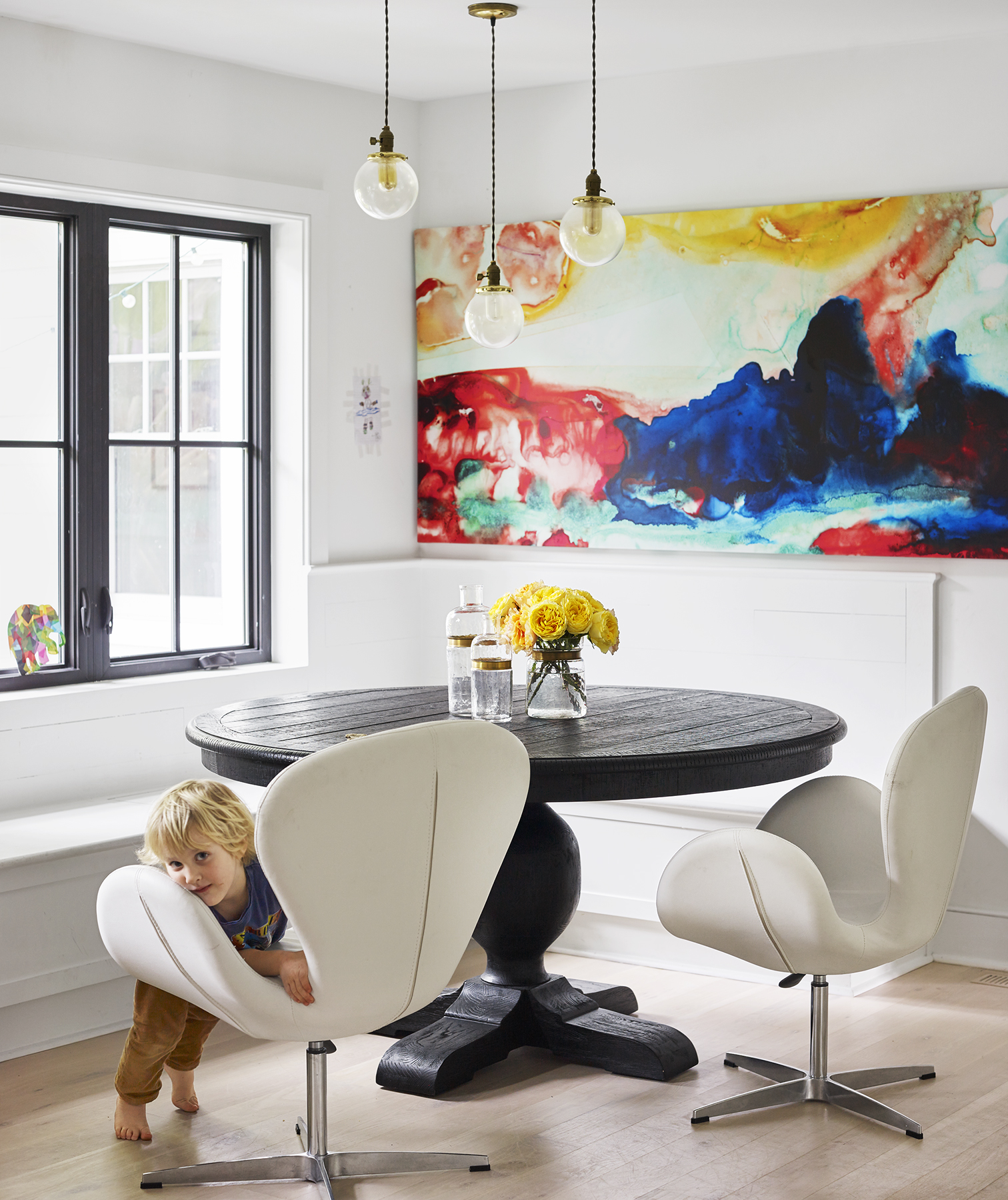 White dining room with bold colorful painting