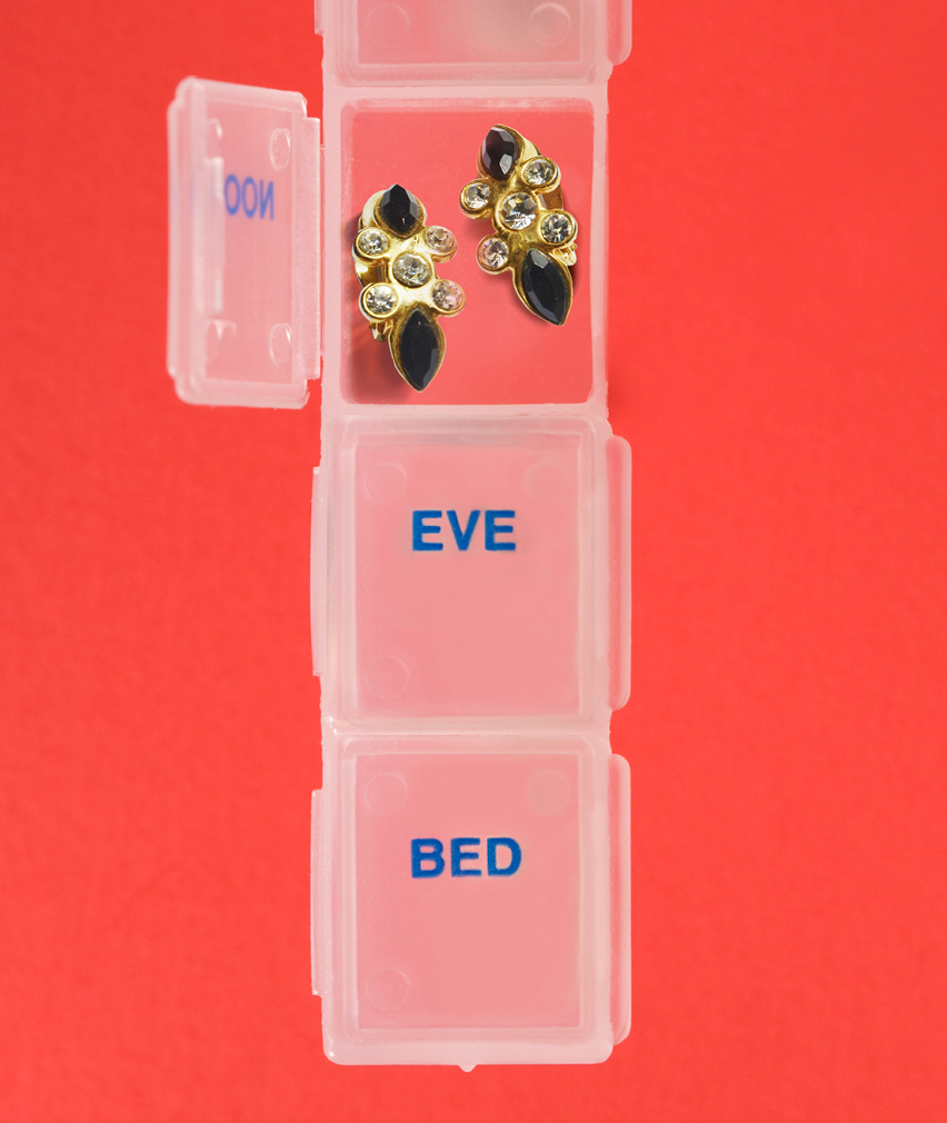 earrings in pill container