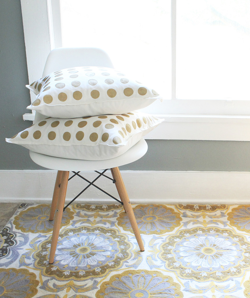 Gold and white polka-dot pillows