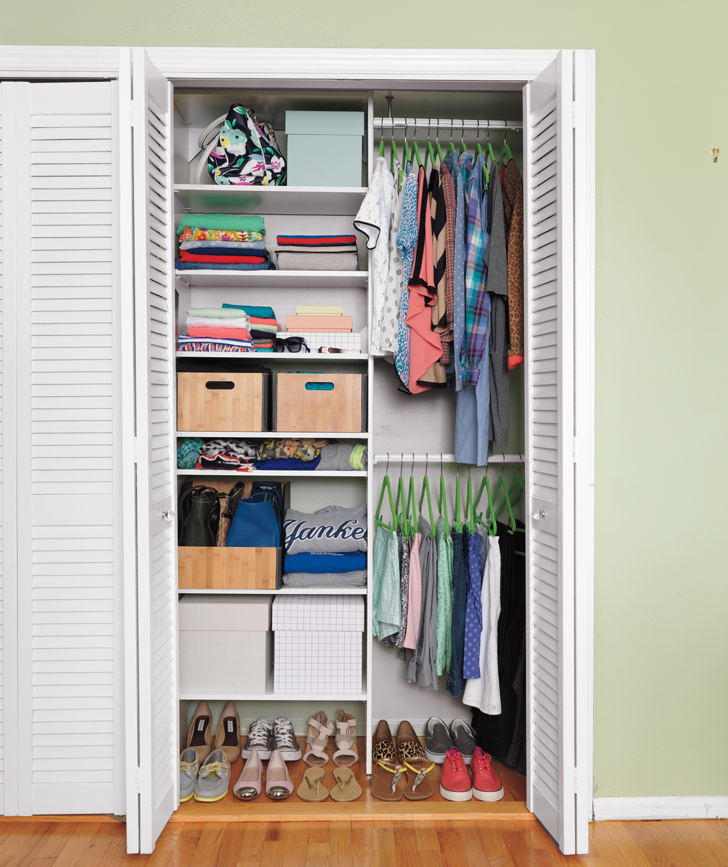 Closet with all green hangers