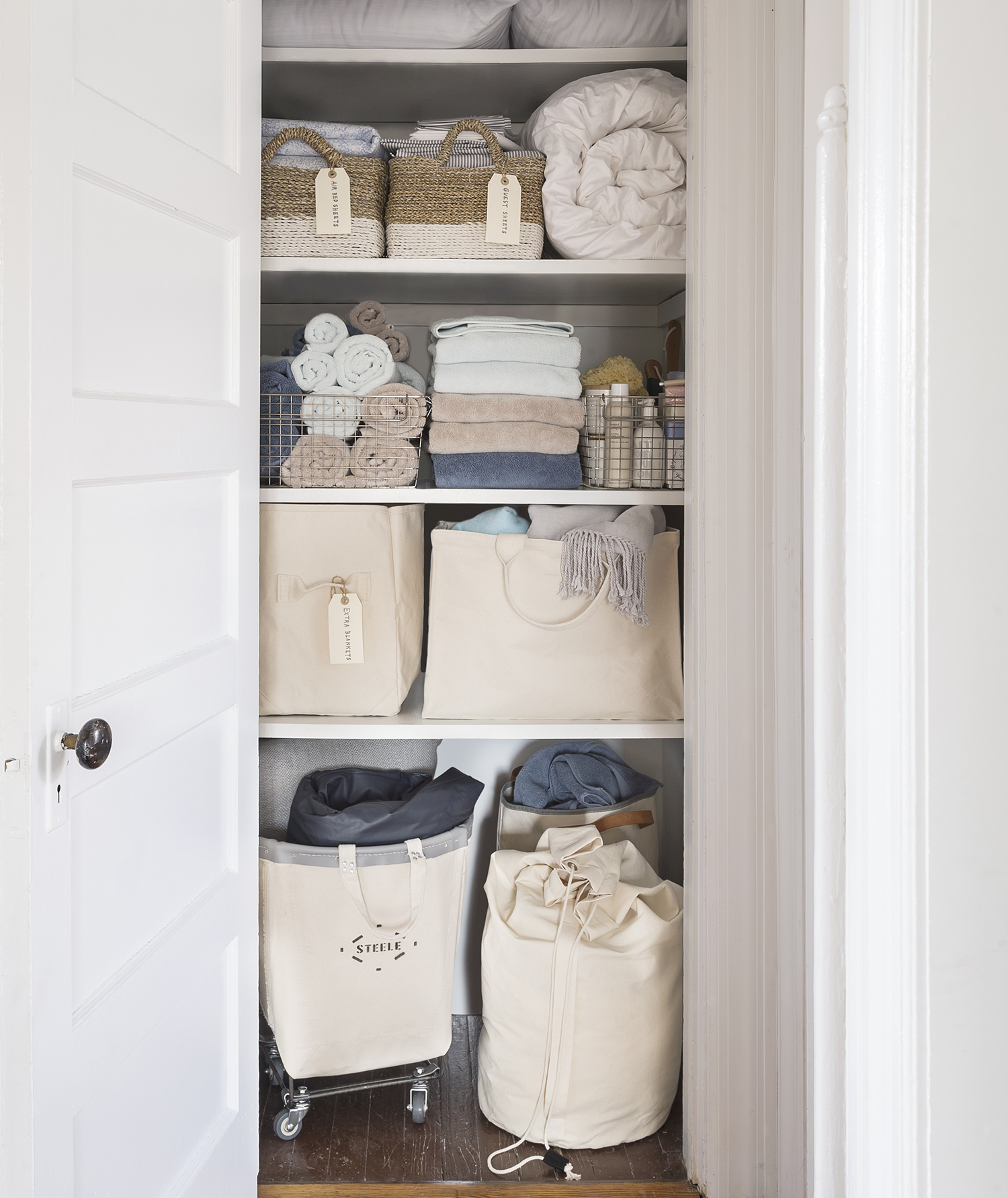 Linen closet with canvas bins