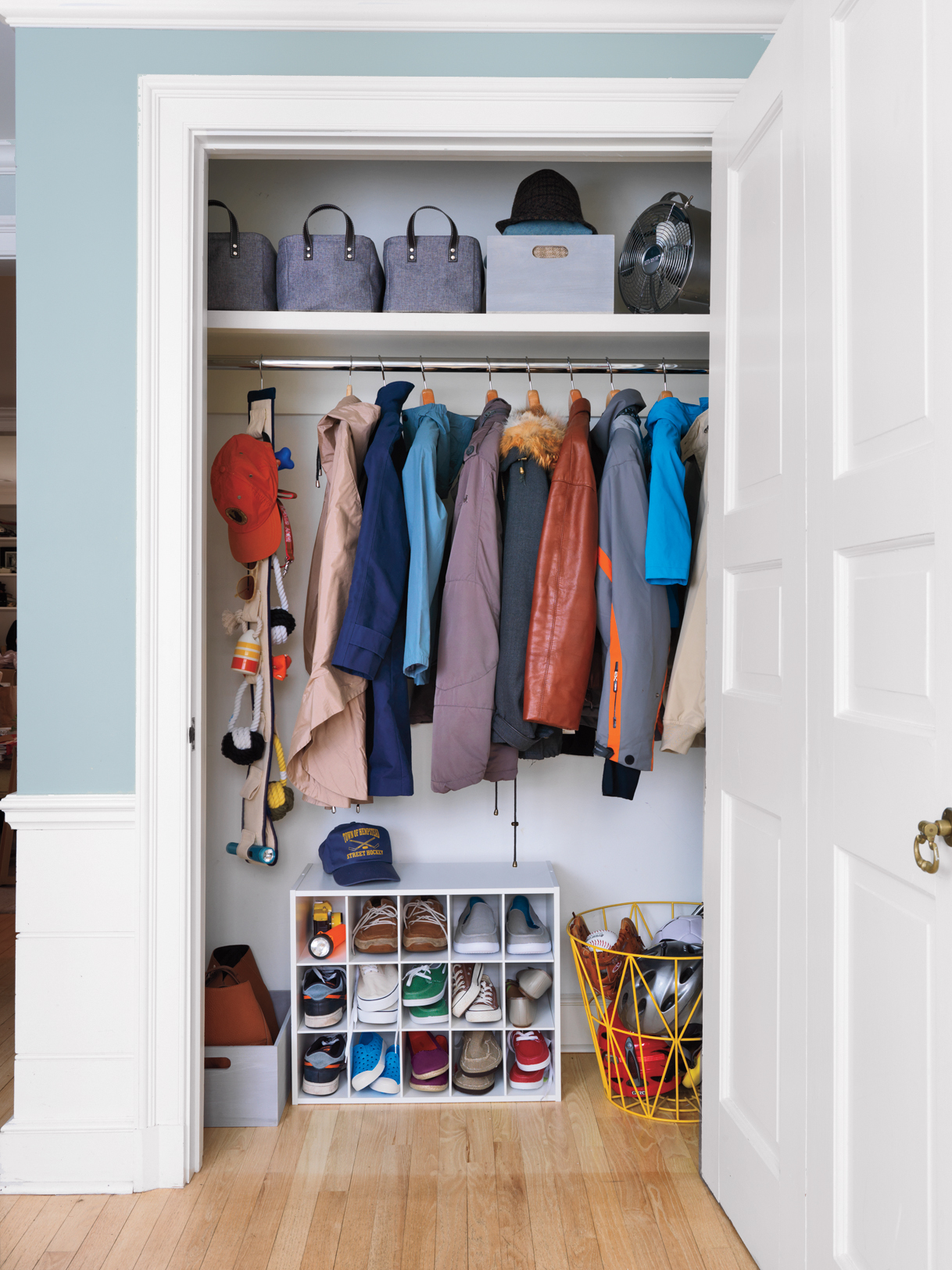 Closet with shoes, clothes, and top shelf organized neatly