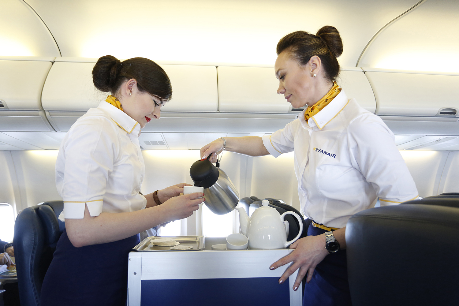 Flight attendants serving coffee