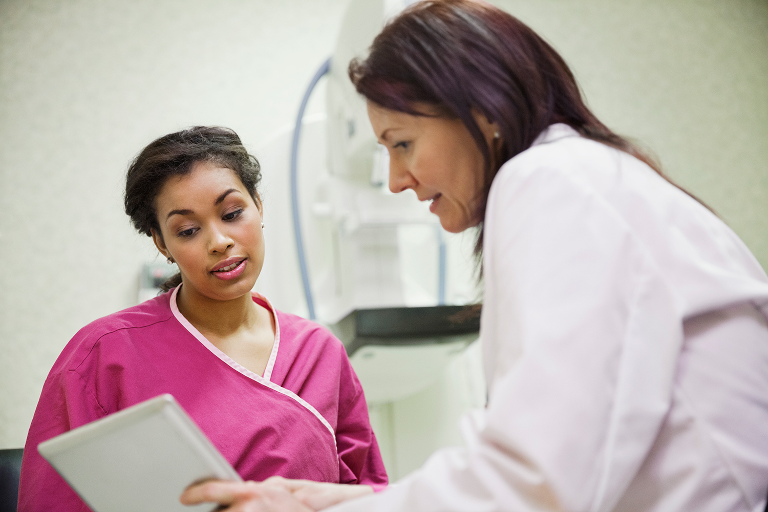 Doctor Explaining Mammogram