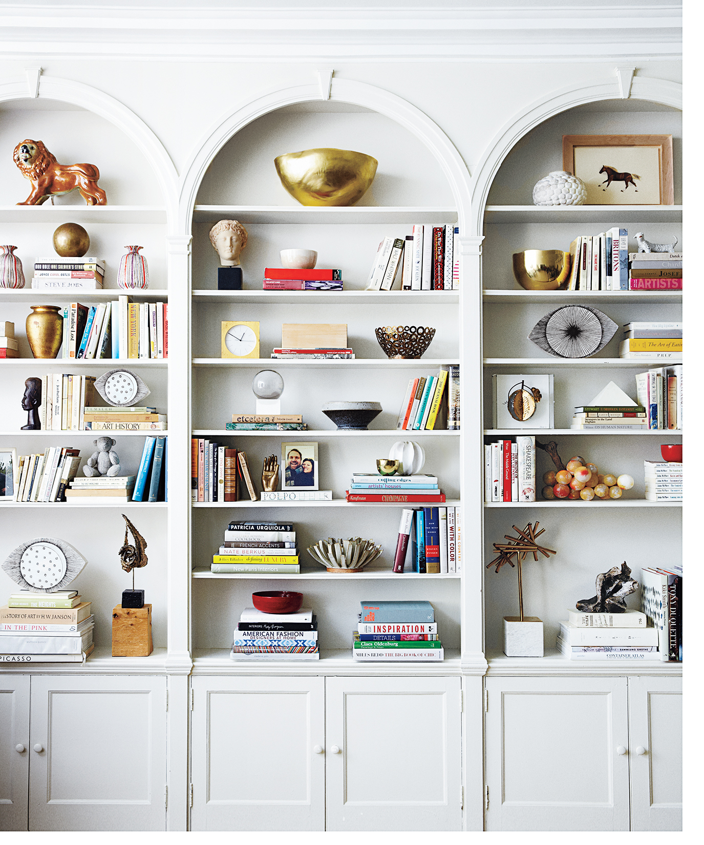 White bookcase with books and assorted objects on the shelves