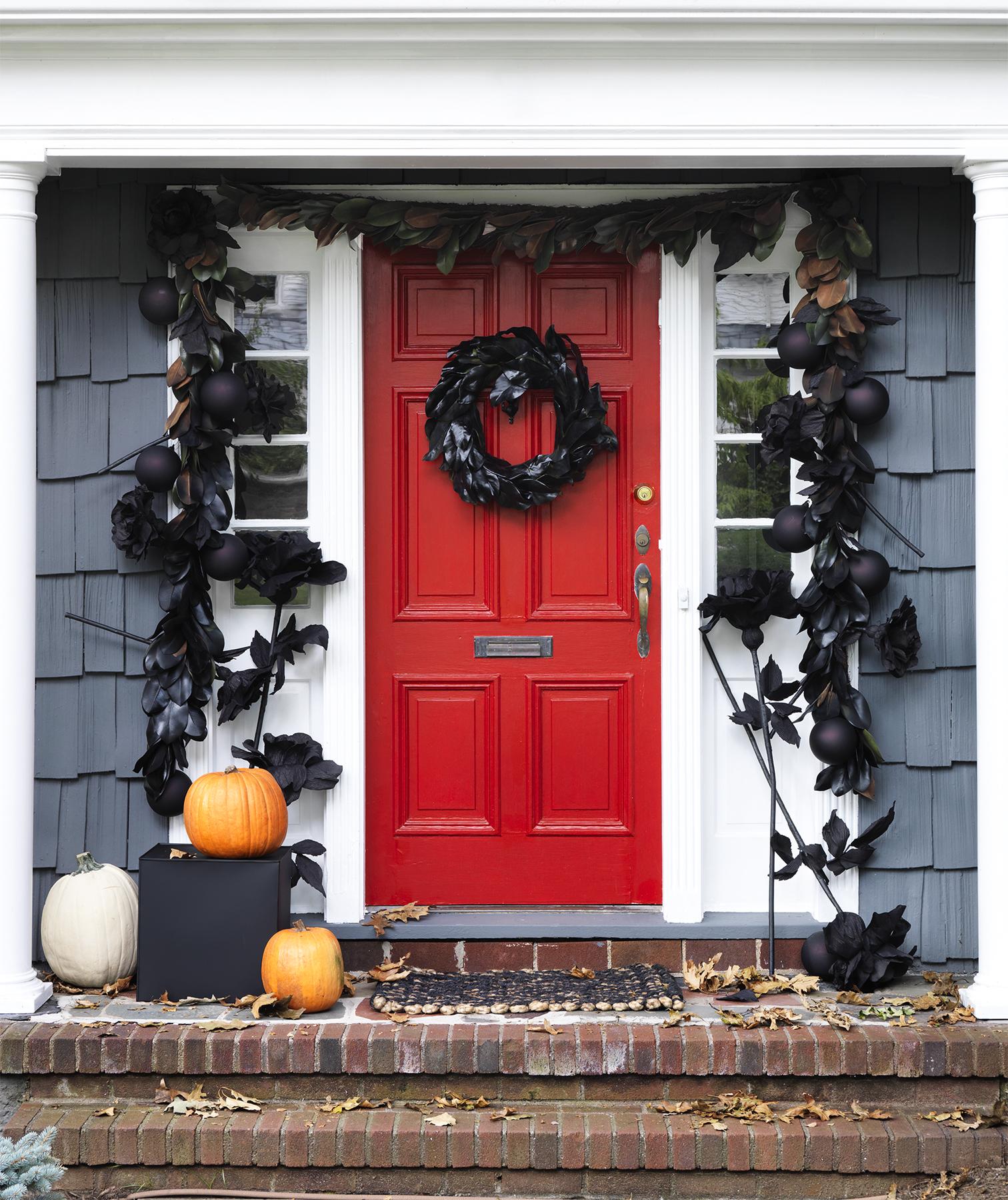 Red door decorated for Halloween