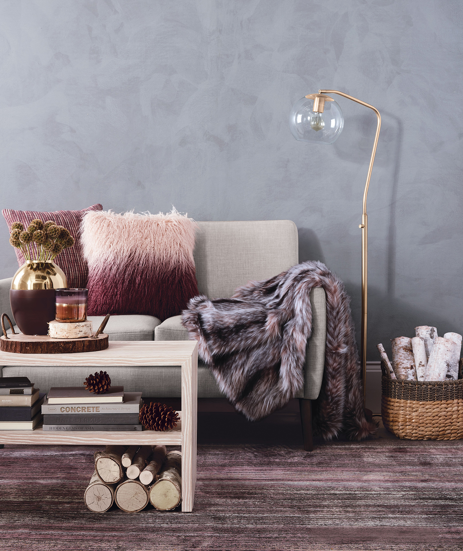 Room with purples pinks and blues, pillows and throws