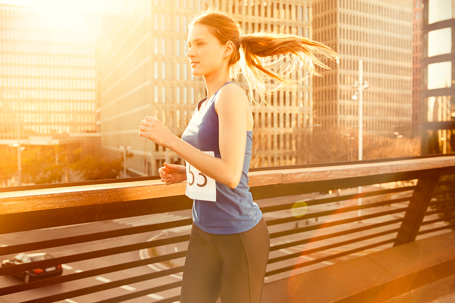 Woman Running in a Marathon During Sunset