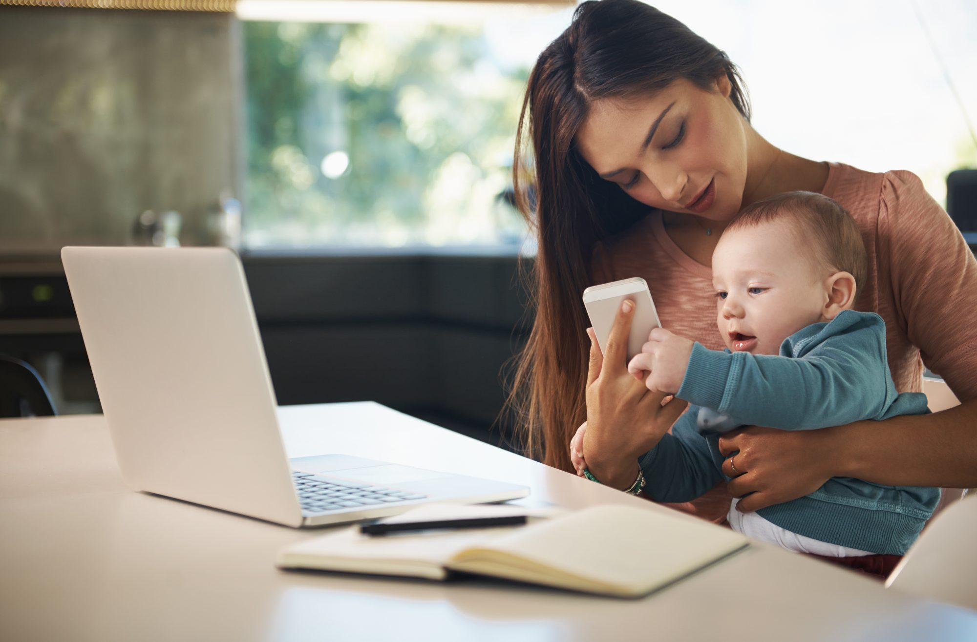 woman-with-phone-and-baby