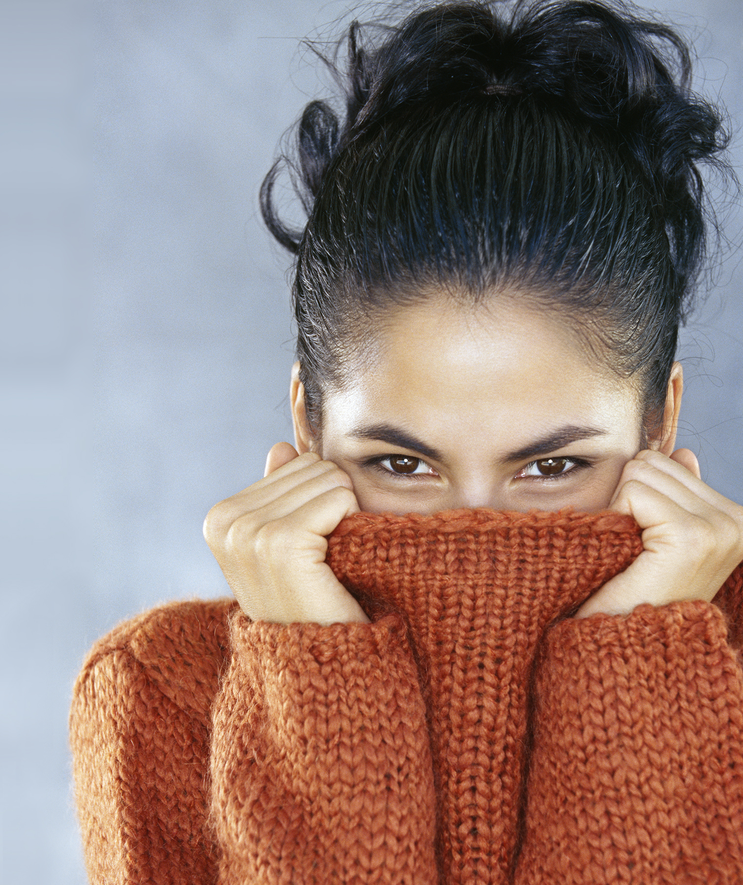 Woman with rust orange roll neck sweater