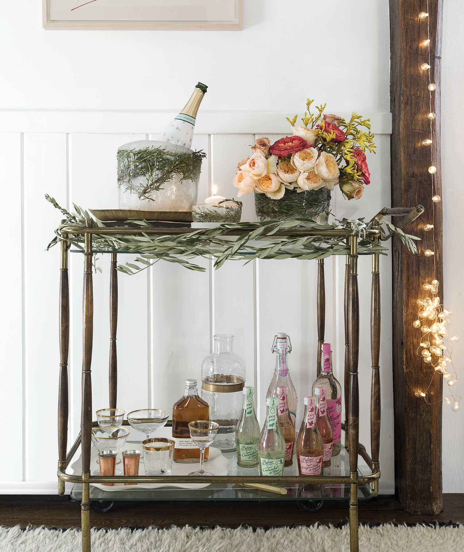Bar cart decorated with olive branches, flowers