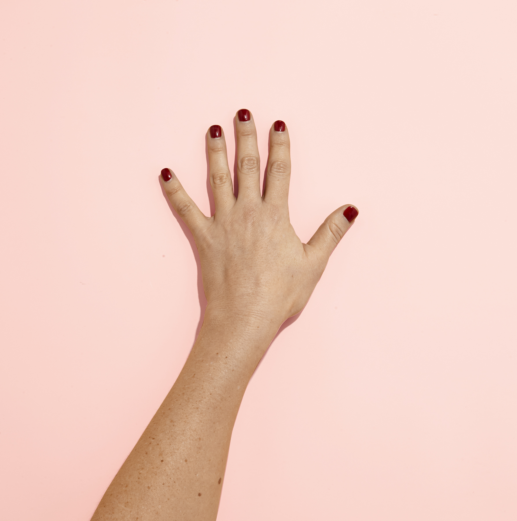 Hand with red nail polish