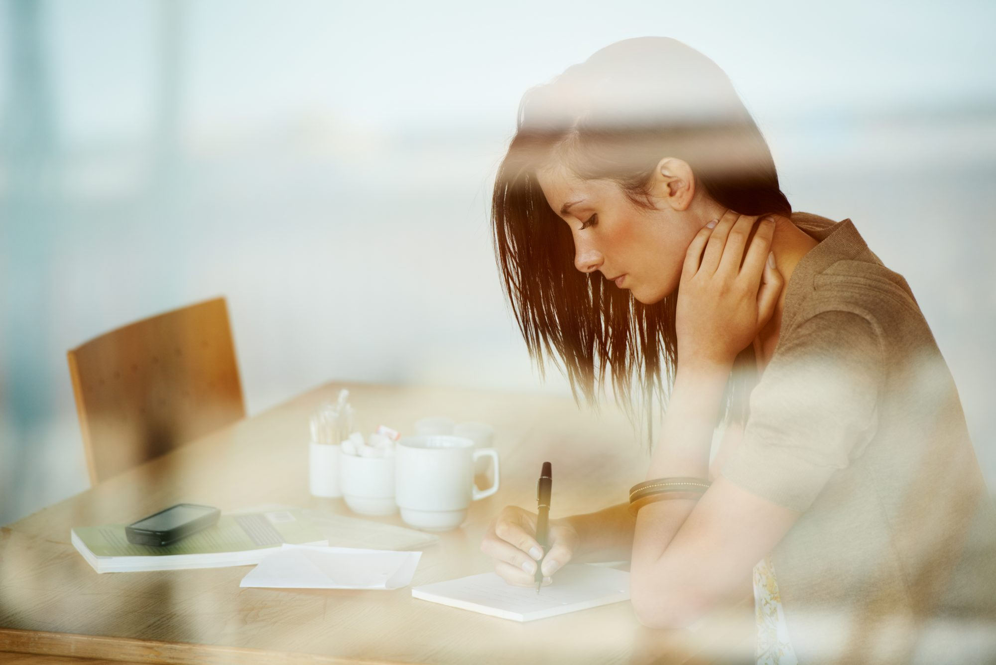 <p>Woman writing journal coffee</p>