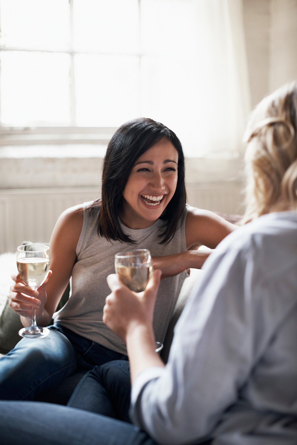 women-drinking-laughing