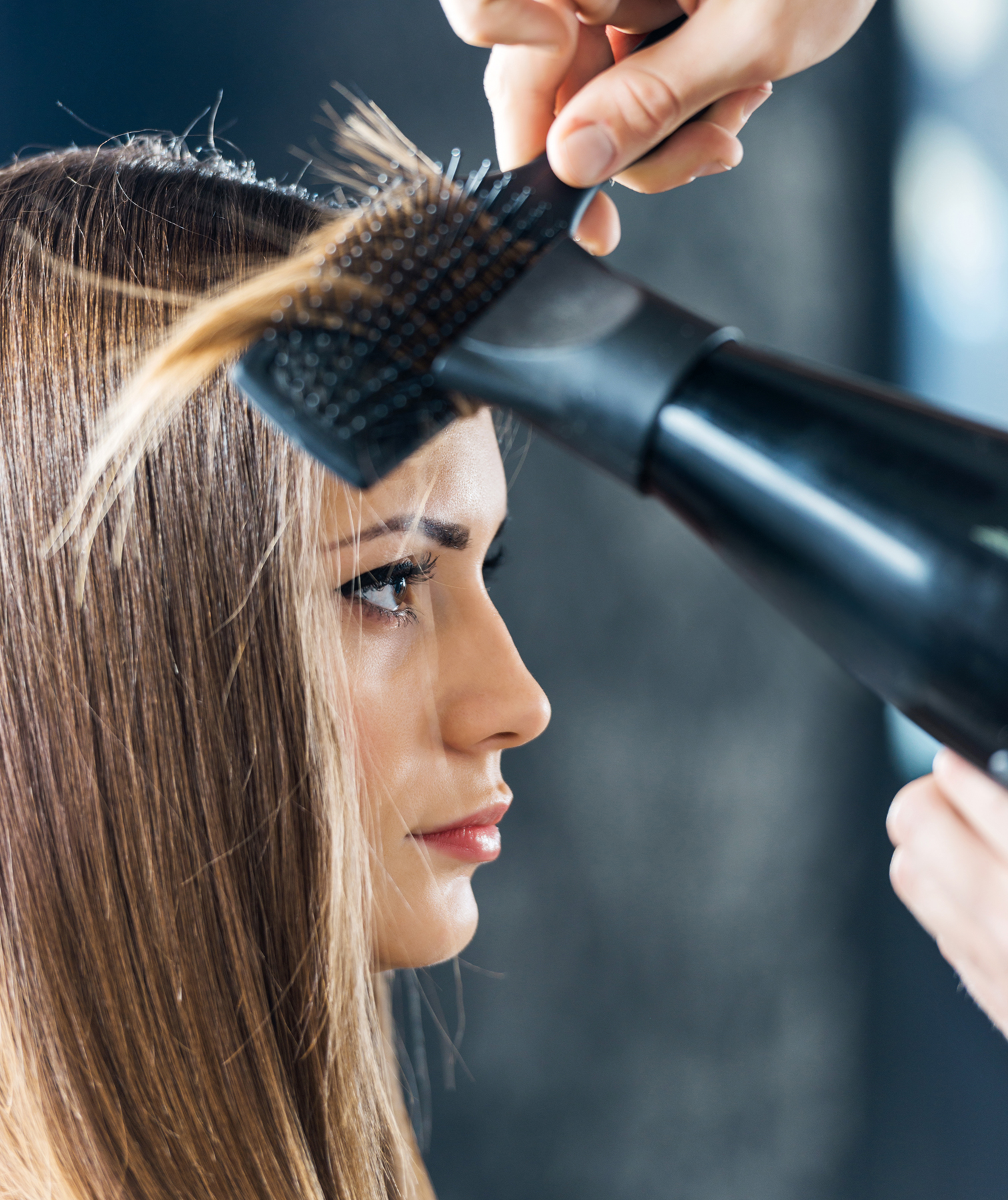 Woman getting blowout at salon