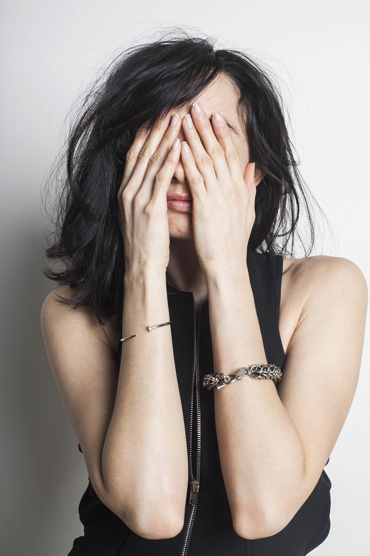 Woman covering her eyes, face