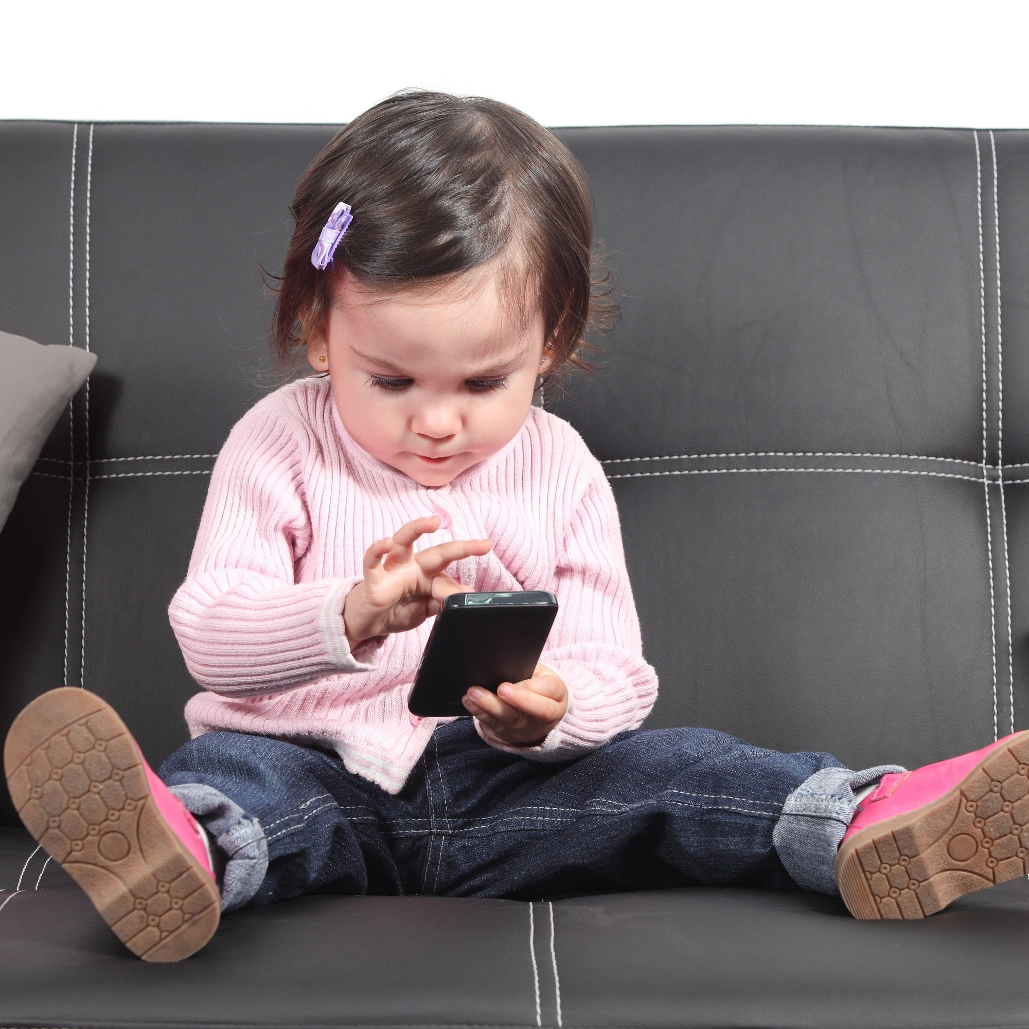 toddler looking at smartphone