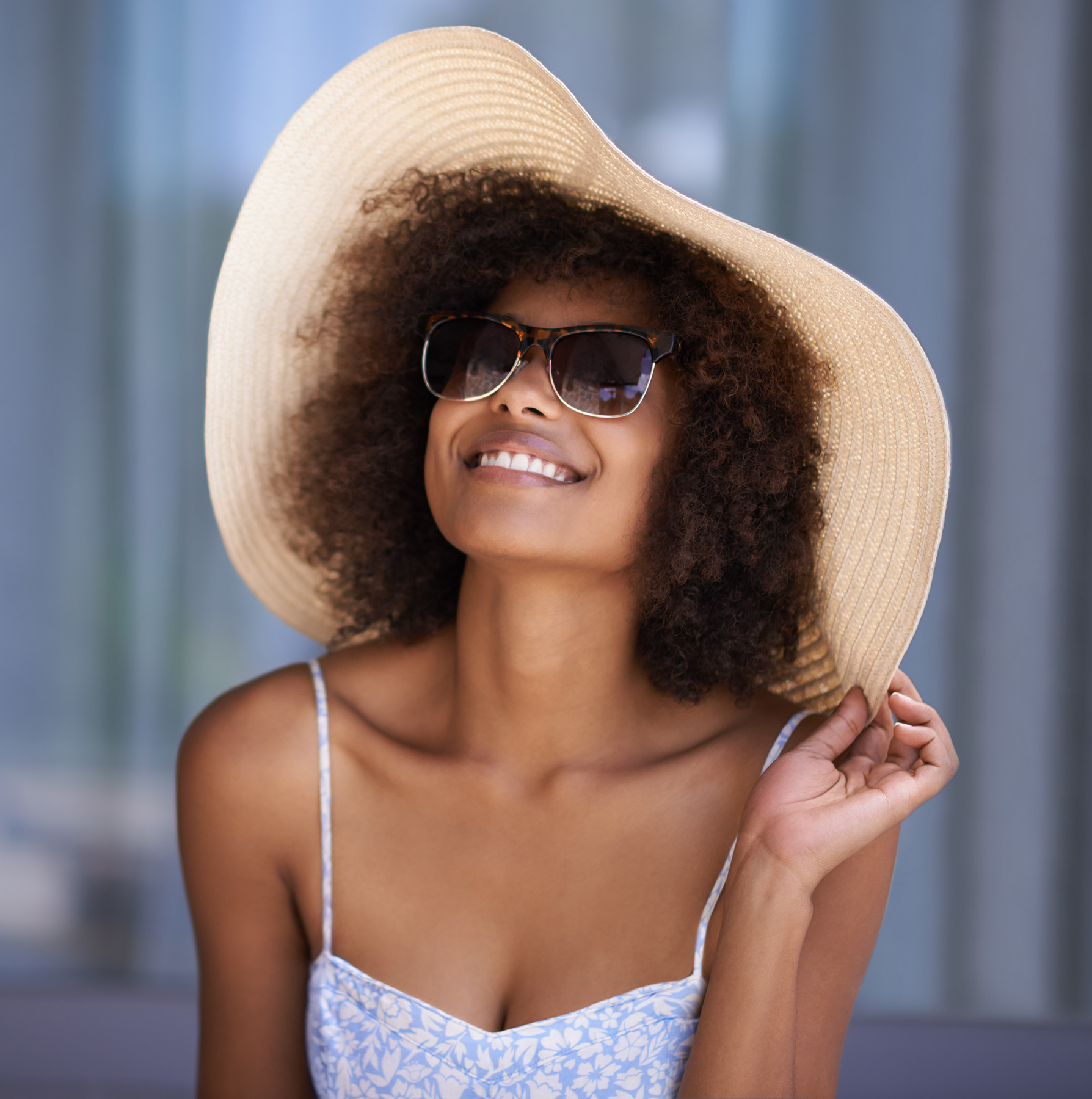 Woman wearing sun hat and sunglasses