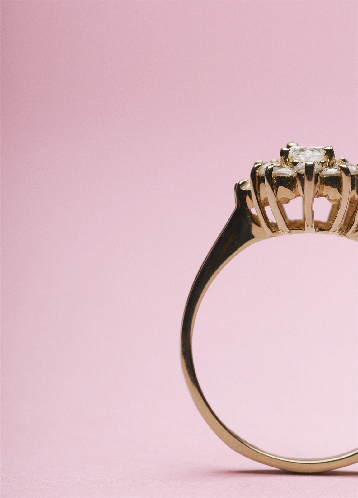Engagement ring on pink background