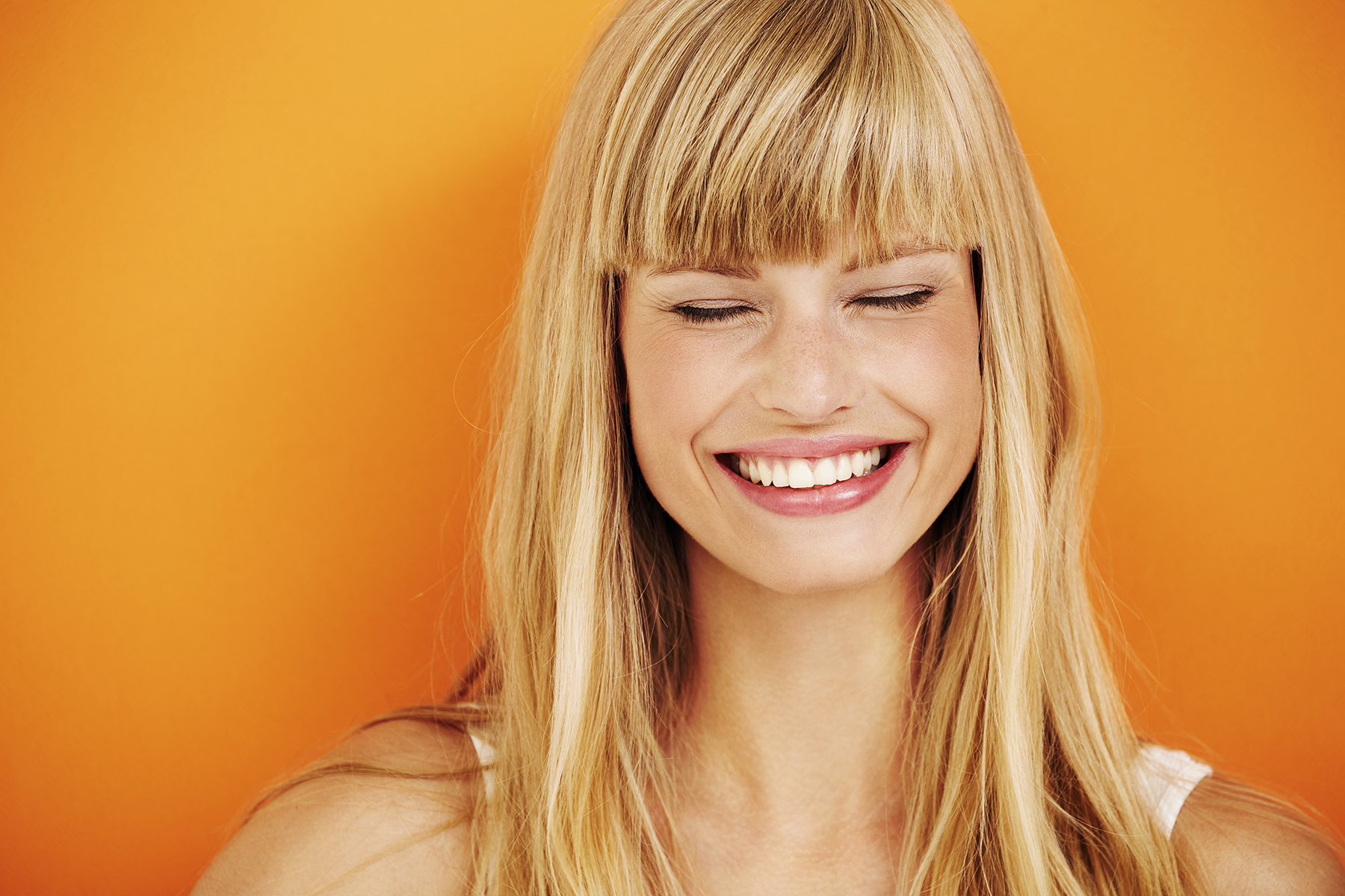Laughing woman with bleached blonde hair