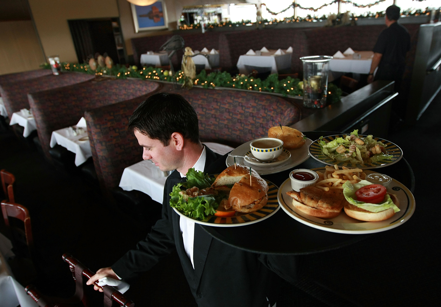 Waiter Bringing Food to Table