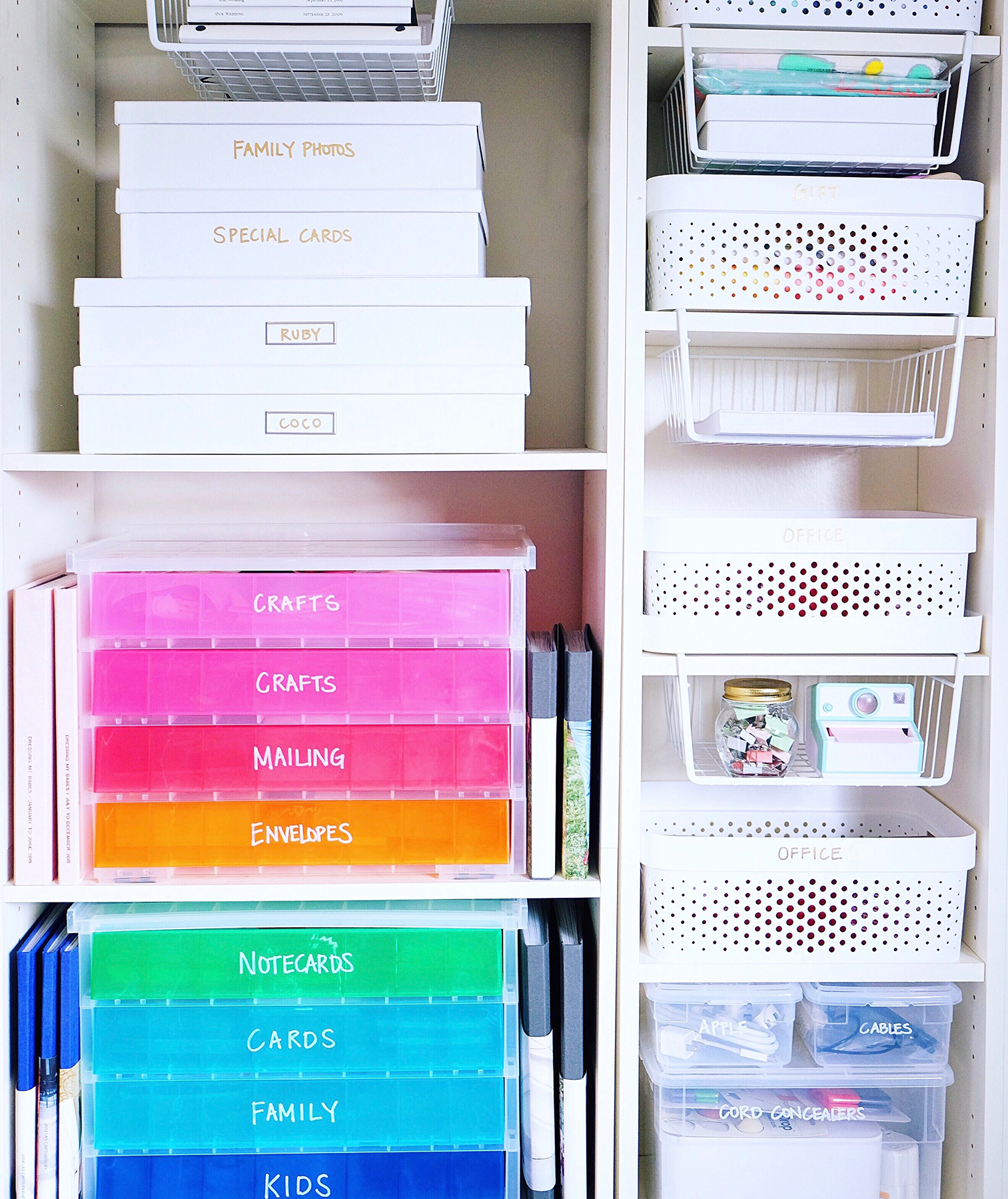 Office supplies in rainbow bins