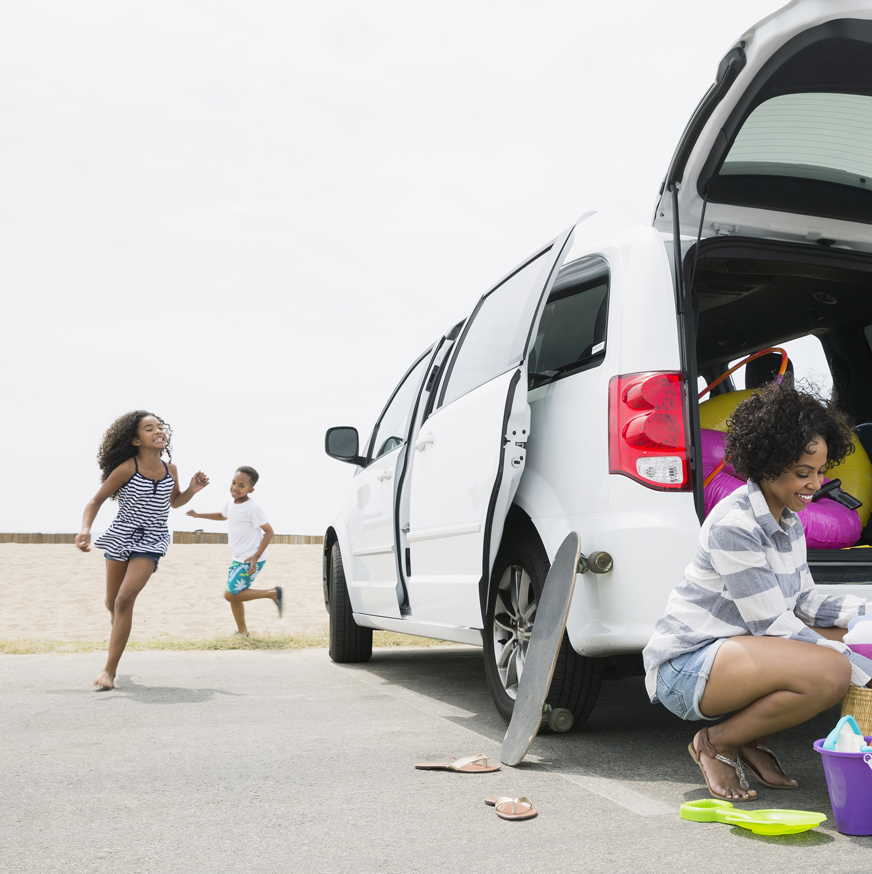 Kids and minivan at beach