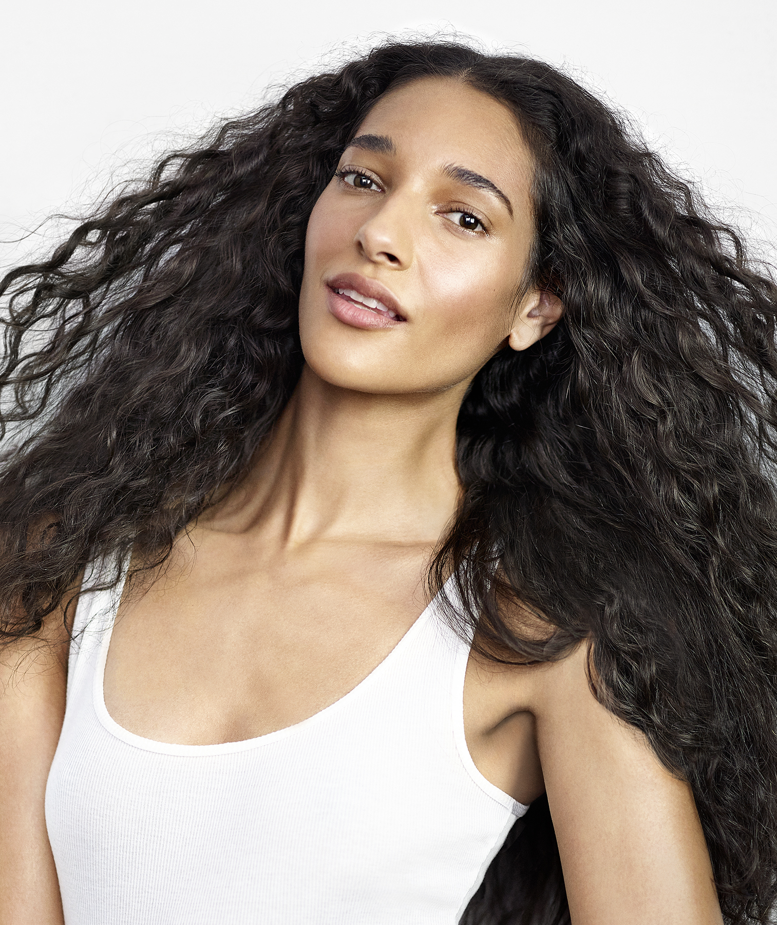 Model with air-dried curly hair