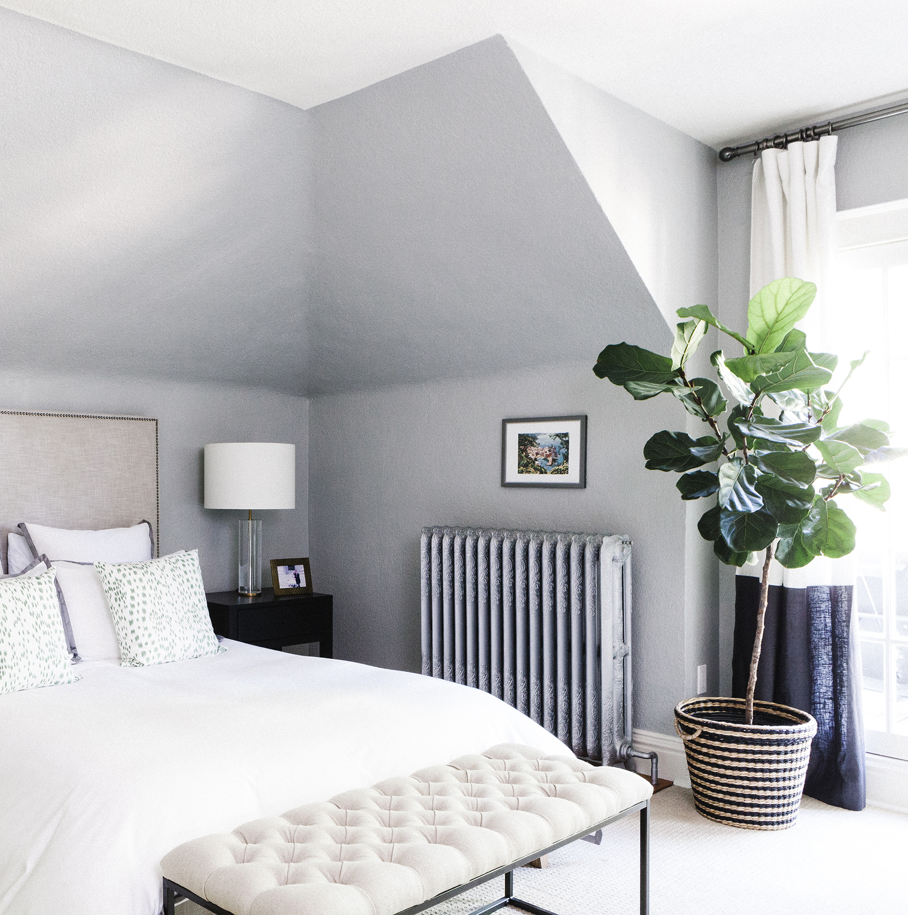 Bedroom with fiddle leaf fig tree and bench