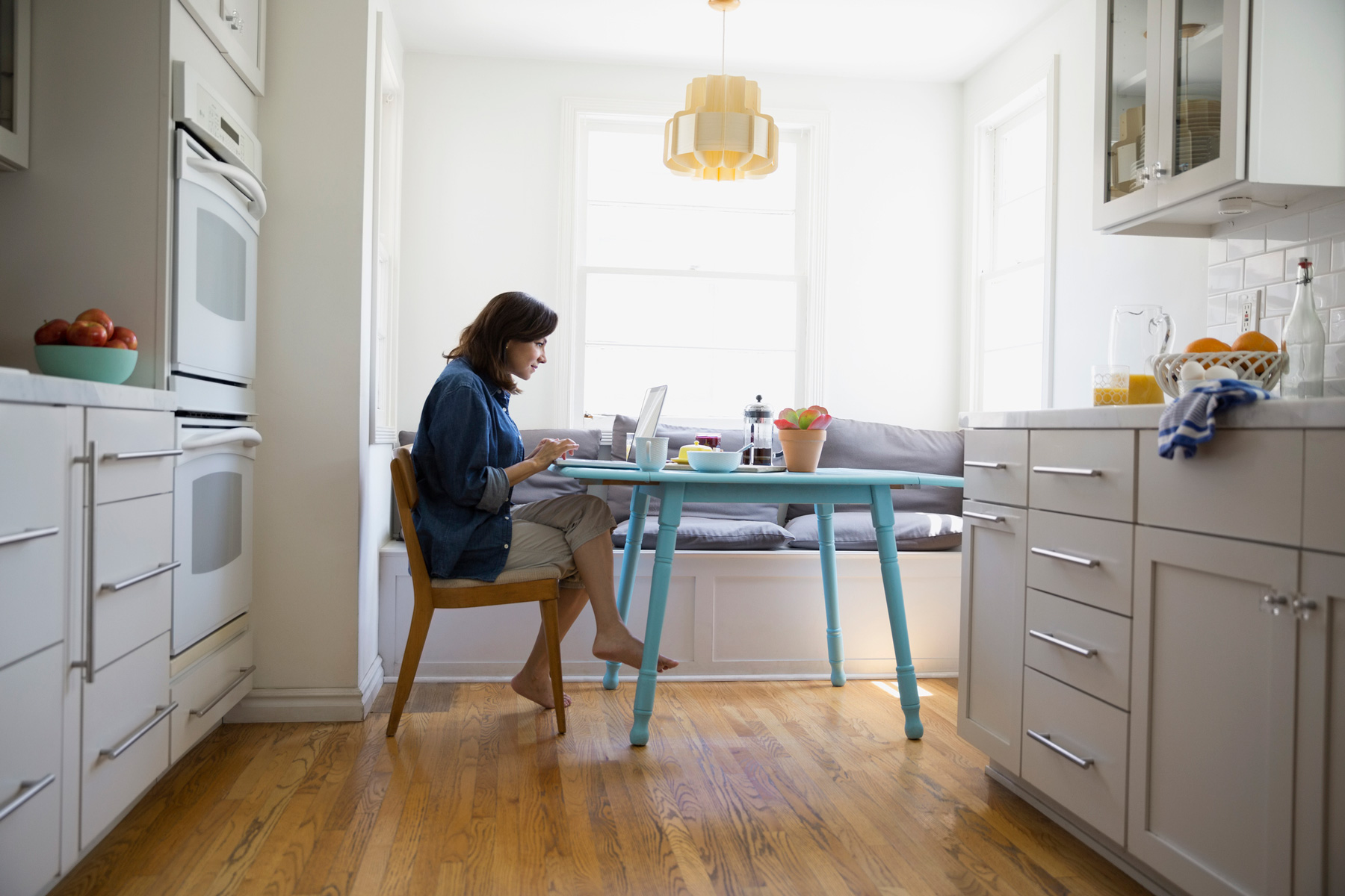 Woman working from home at kitchen table