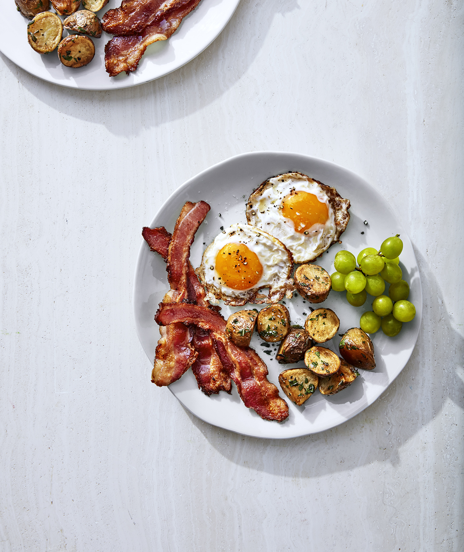 Crispy Fried eggs With Rosemary Potatoes and Bacon