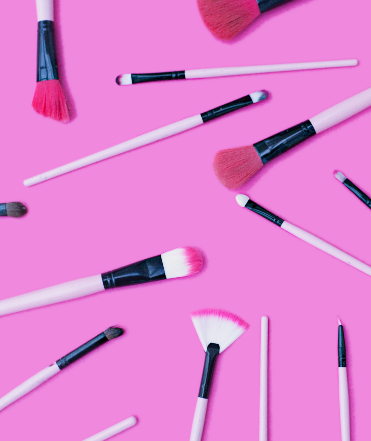 Makeup brushes on pink