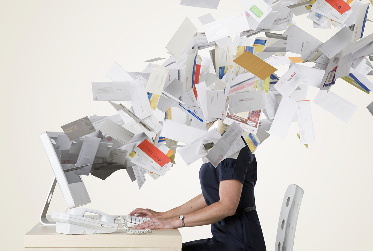 Woman at work flooded with emails