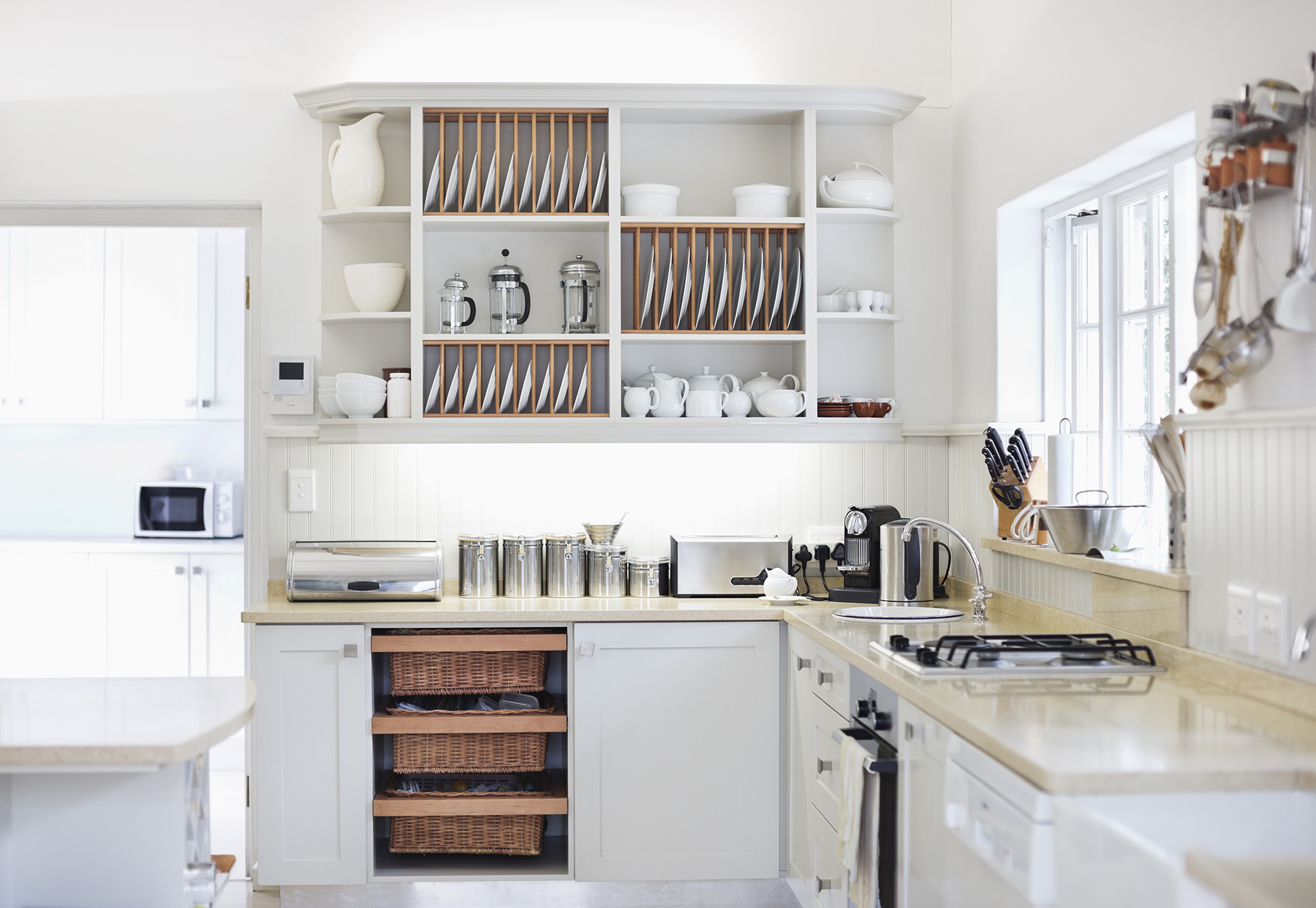 Pale yellow and white kitchen with open shelves