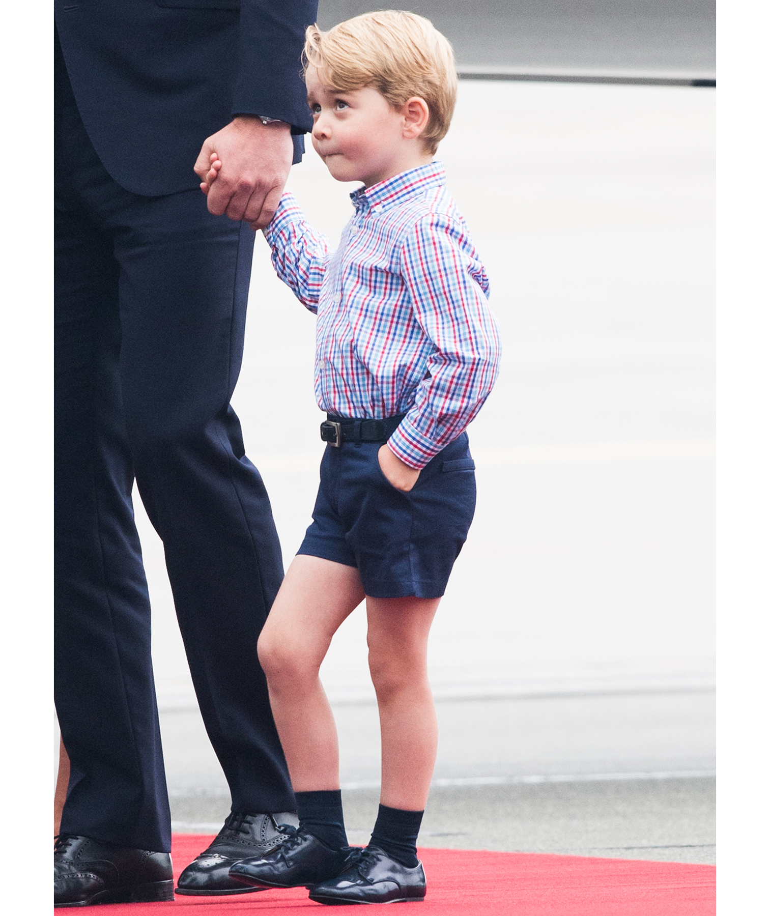 Prince George in shirt and shorts