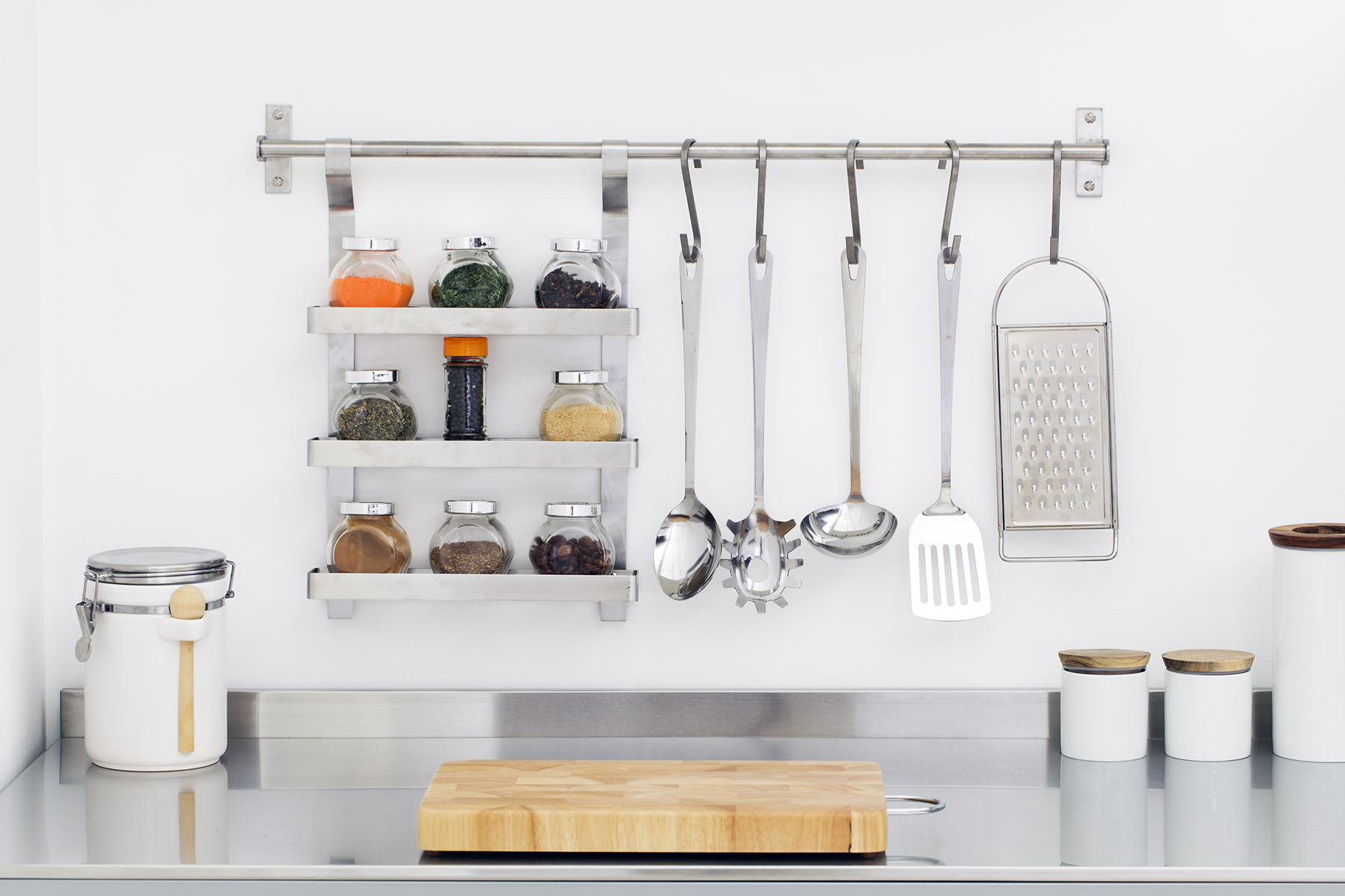 Kitchen counter with canisters and hanging spoons