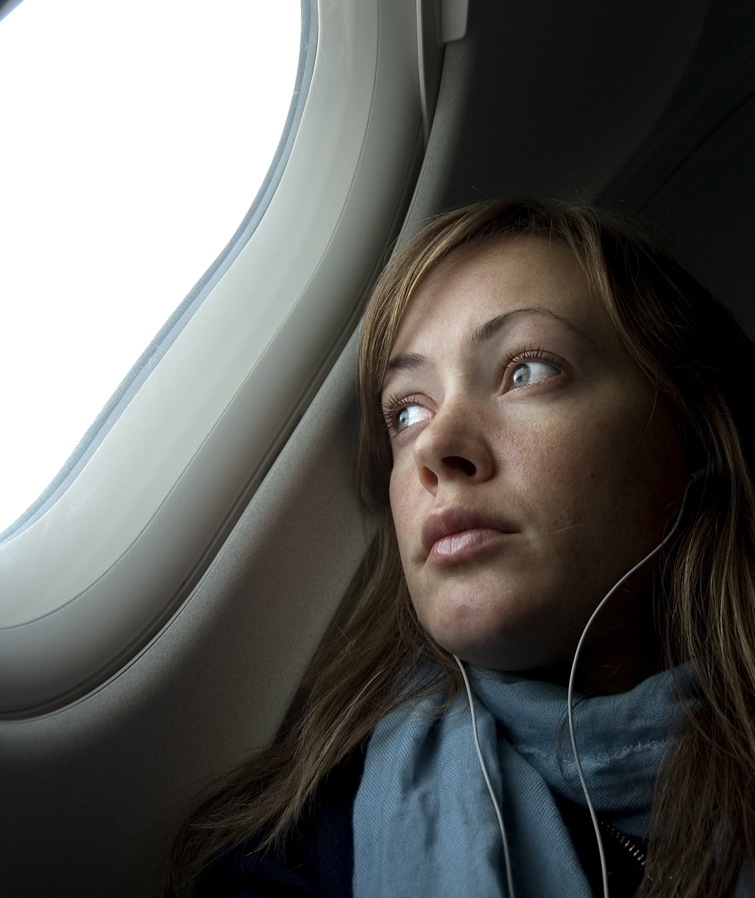 Sad woman on a plane