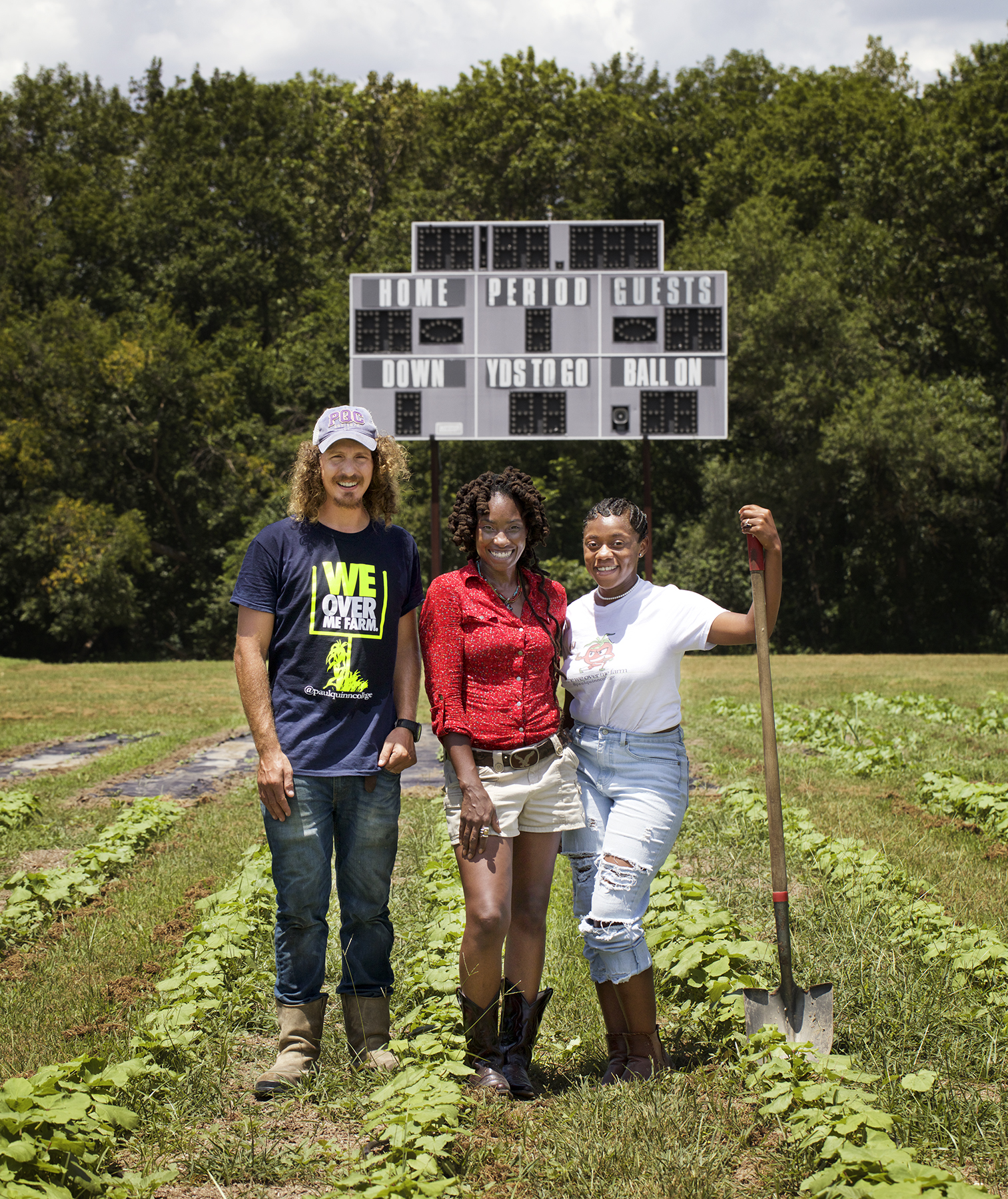 College farm director and staff in field