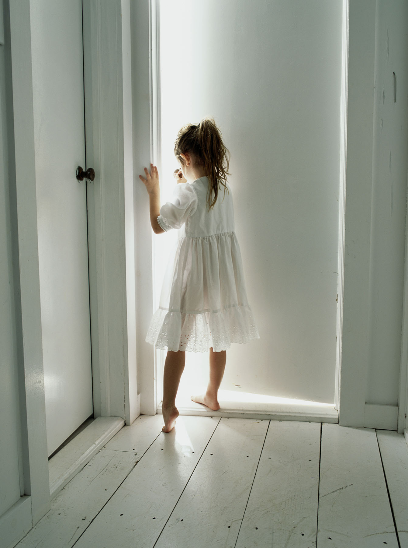 Girl standing in doorway