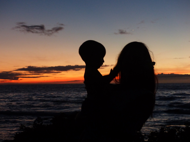 Mom and baby at sunset