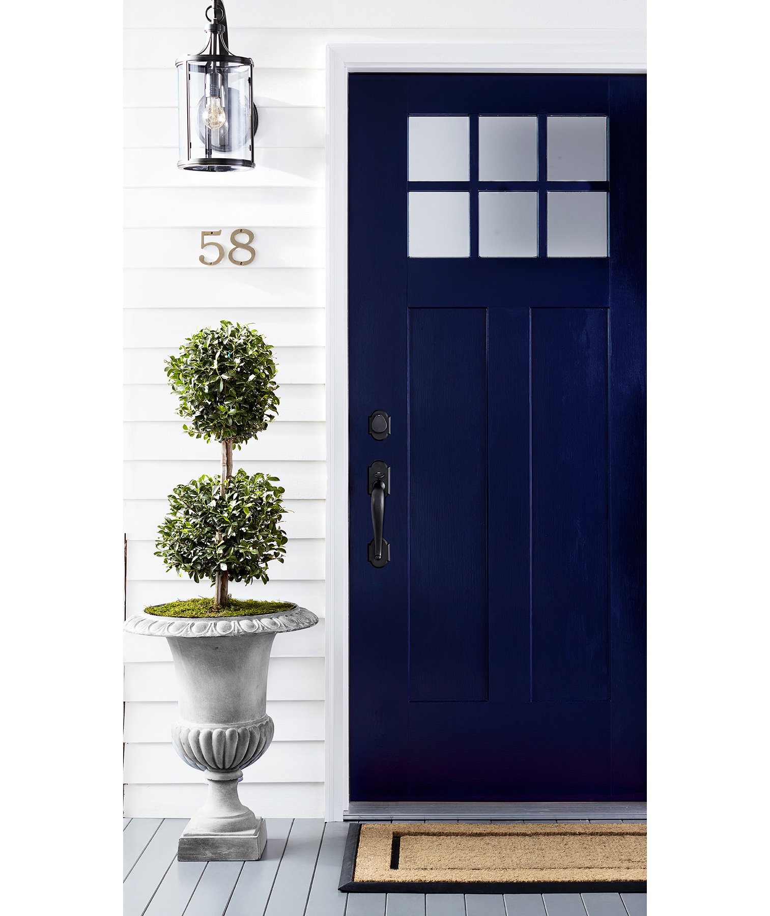 White classic house with dark blue front door