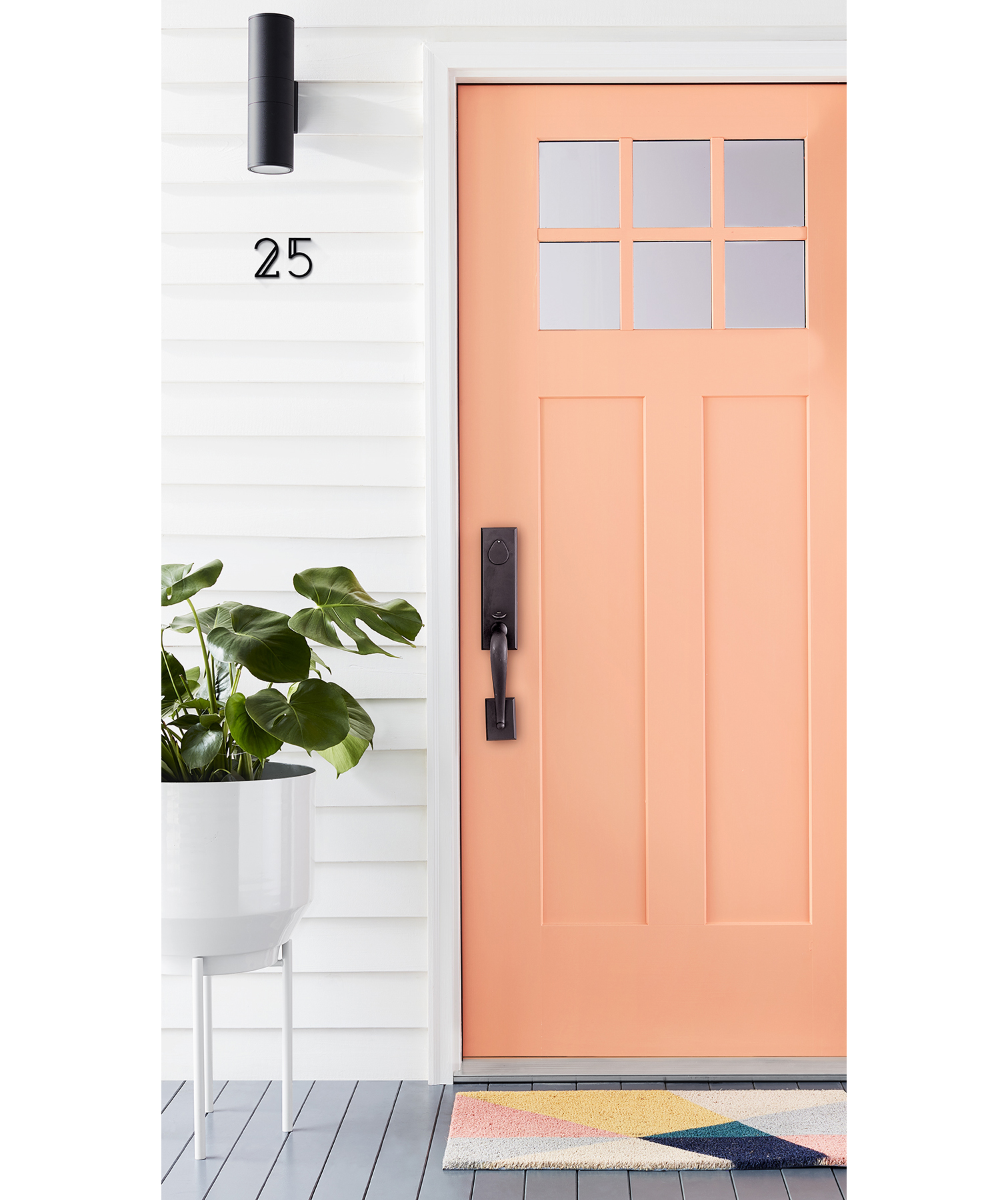 White Modern House With Peach Front Door