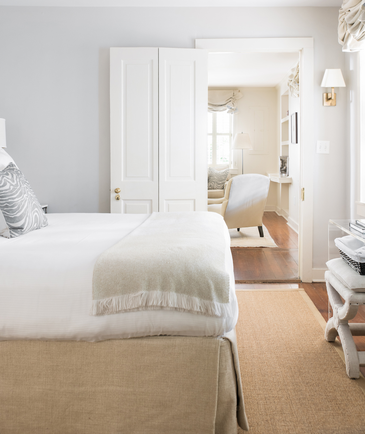 White bedroom with pale neutral accents