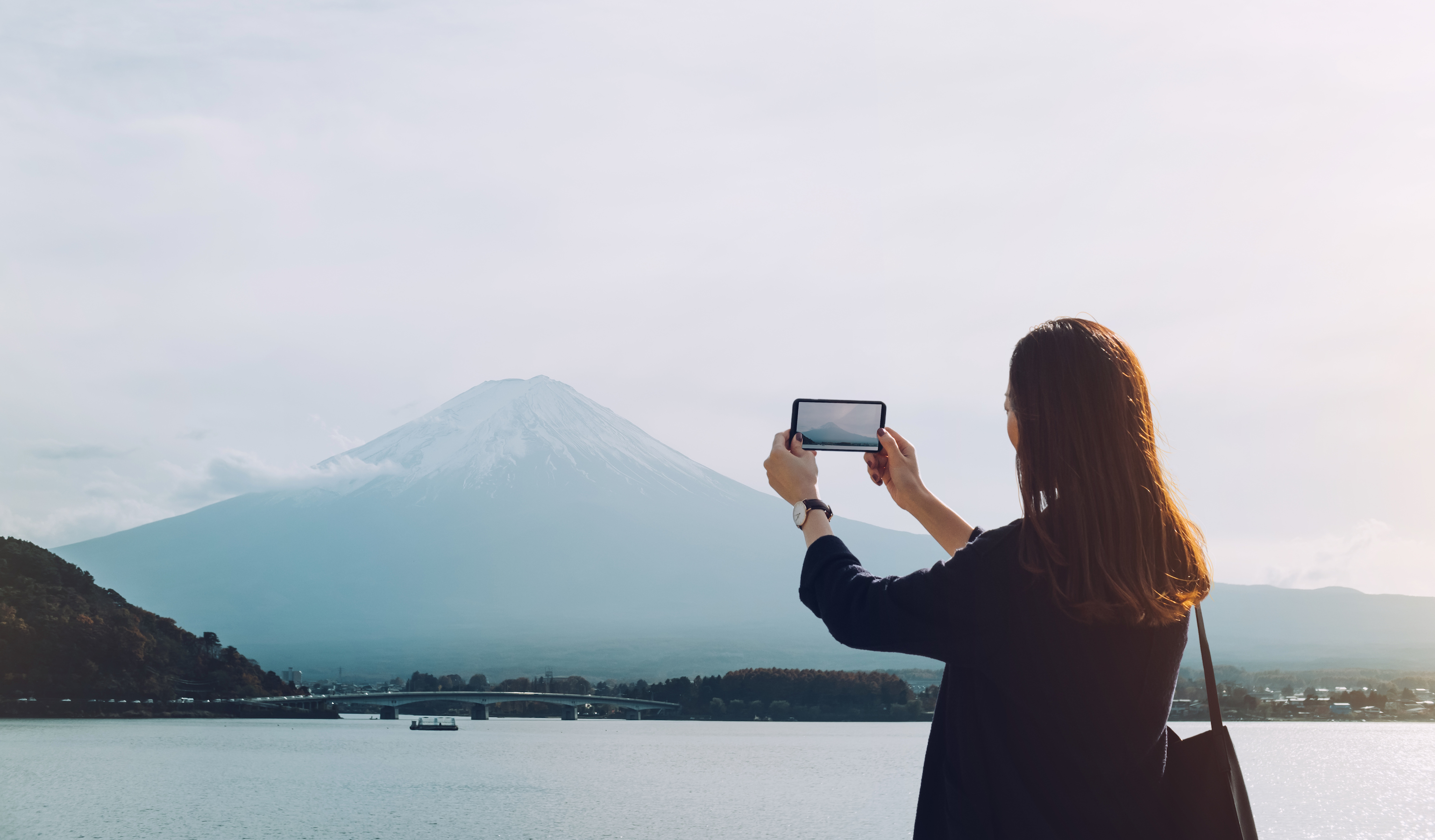 Woman taking photo of Mt. Fuji in Japan